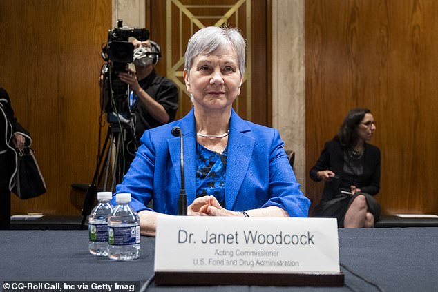 Dr Janet Woodcock (pictured) is the agency's acting commissioner, although her interim term is due to expire next month.  While he is being considered for a permanent role, he is facing opposition from some Democrats in the Senate.