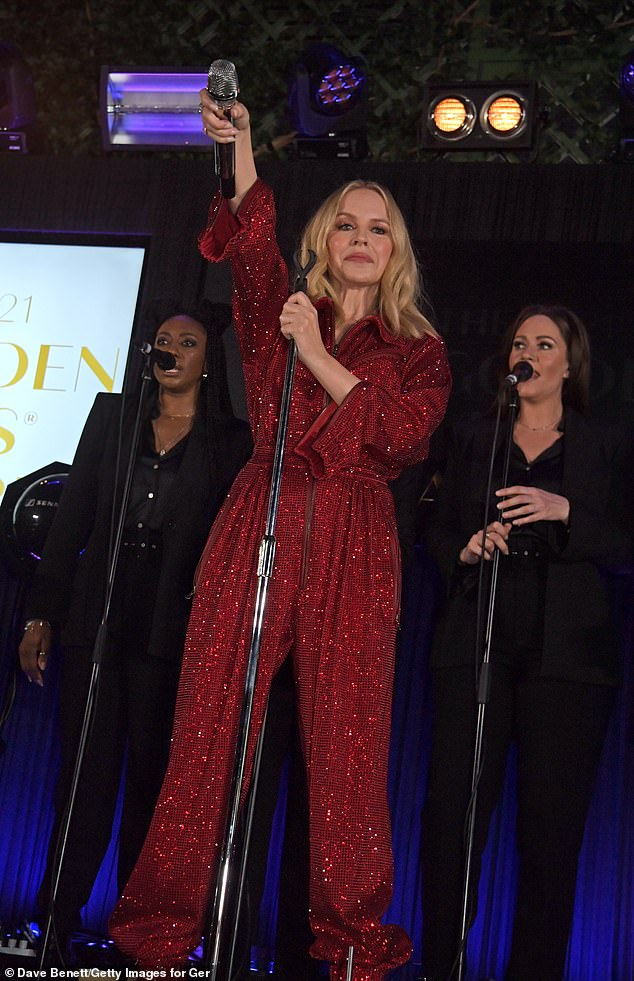 Facelift: She later changed into a red jumpsuit to perform her hits on stage