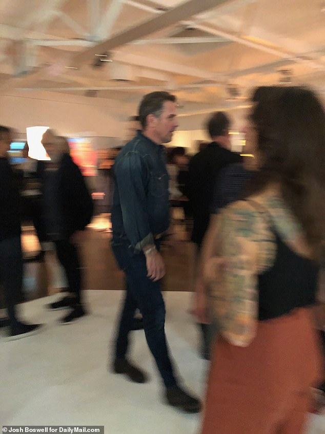 The president's son and his gallery manager Georges Bergès entertained about 200 guests as he made his professional art debut at Milk Studios in Hollywood