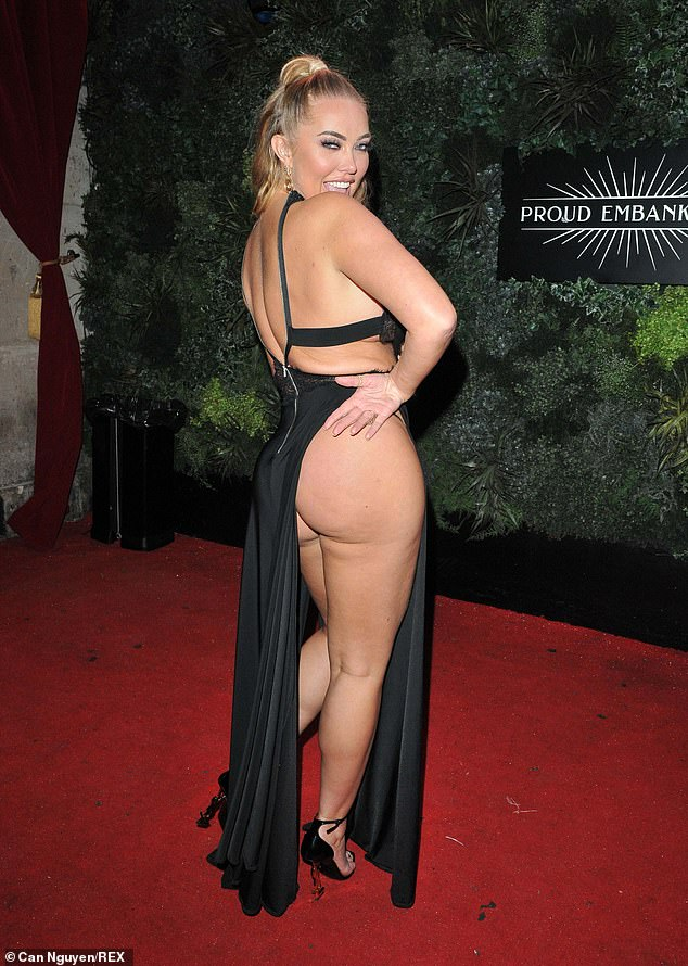 Some, like reality TV star Aiseline Horgan-Wallace, have taken the trend even further, exposing her entire derriere in an almost black cutaway dress that barely covered her bottom.  She stepped out in figure flaunting style at a charity event in London on Wednesday night