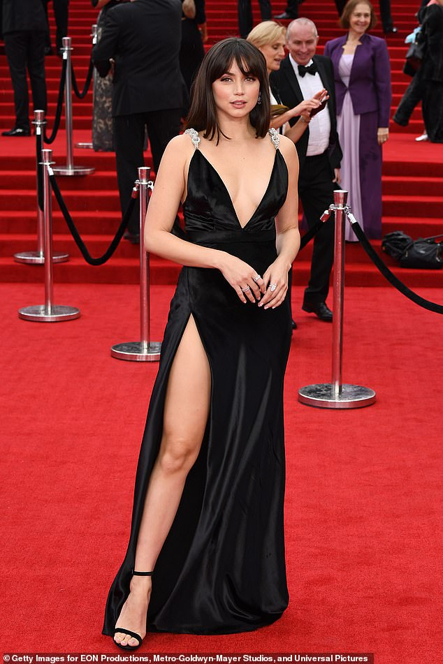 Bond girl Ana de Armas, who sought attention at the No Time to Die premiere, showed off her toned pins in a thigh-slit black gown with a plunging neckline.