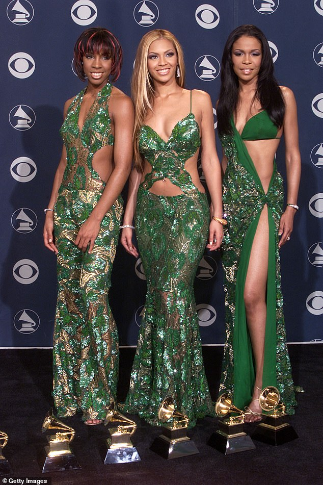 The naughties are back: Michelle Williams (right) sported a very daring bare look with a thigh-high split at the 2001 Grammys with her Destiny's Child bandmates Kelly Rowland (left) and Beyonce Knowles (center).