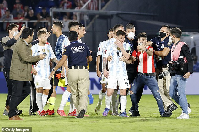 Some fans invaded the pitch after full-time and attempted to take selfies with Messi