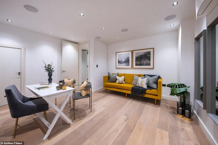 The basement level (pictured) provides the home's two spacious bedrooms, a shared bathroom, and a utility room
