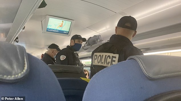 Armed French police have boarded a London-bound Eurostar and arrested a British passenger after a train manager accused him of wearing 'the wrong type of mask'