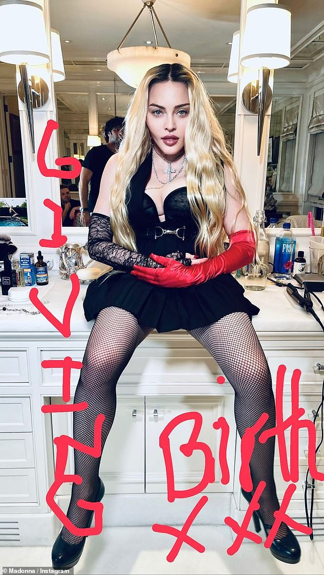 Making a statement: The Material Girl also scribbled 'giving birth' across a photo of herself sitting on top of a bathroom sink decked out in a skirt and bustier combo