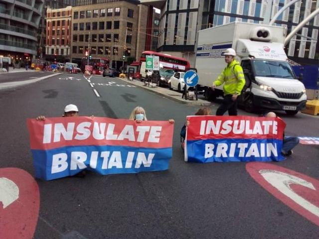 The eco protestors seen targeting Old Street roundabout by sitting down and holding up banners in London today during their latest disruptive rush-hour protest