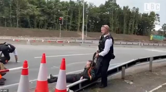 Police appeared to swiftly leap into action at the M25, racing into the road to drag out the protesters by their high-vis vests