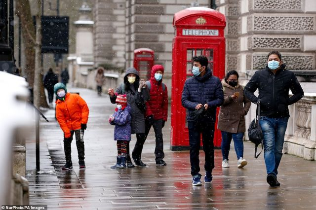 However, from Monday, a blast of chilly air will sweep across the country from Iceland, bringing the temperatures down again. Pictured: File image of people walking through London on February 9, 2021