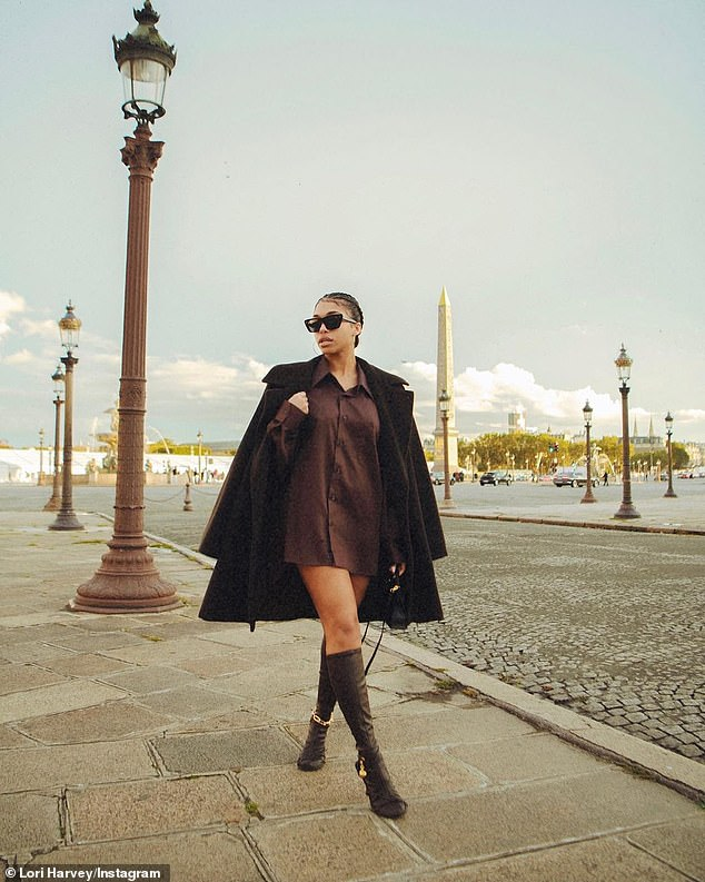 Head to toe: Lori delighted her almost 4 million followers with an all brown look that consisted of an oversized button down shirt that she wore as a dress, Bottega Veneta knee high boots, and a plush chocolate coat