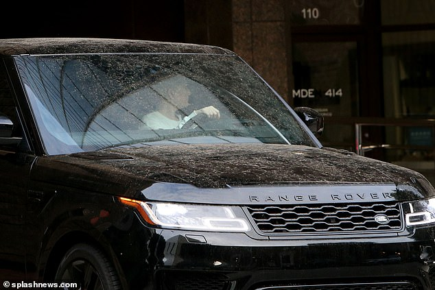 Wash: Erika - who was allegedly paid $25million in expenses by her ex - was seen driving an unclean Range Rover around Los Angeles