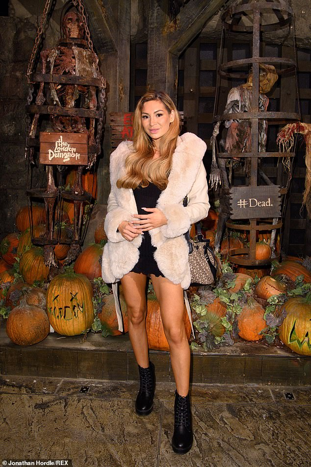 Wow!  AJ Bunker raced to the London Dungeon's Halloween event on Friday with Lucinda Strafford and Lily Haynes flashing her toned legs in a black minidress.