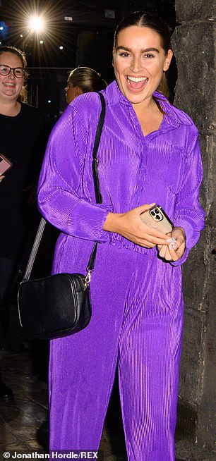 Unacceptable: Chloe Ross sought attention in a flashy purple tracksuit set, which she accessorized with a tiny black leather handbag.