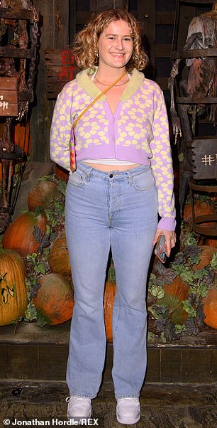 Beauty: Grace Campbell looked gorgeous in a purple hoodie that featured yellow floral prints.  She wore a pair of light blue jeans and a delicate chain necklace