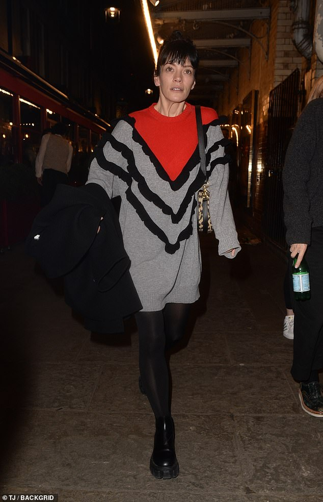 LOOKING GOOD: She paired the number with a pair of black tights and grabbed a coordinating coat while donning a pair of onyx shoes