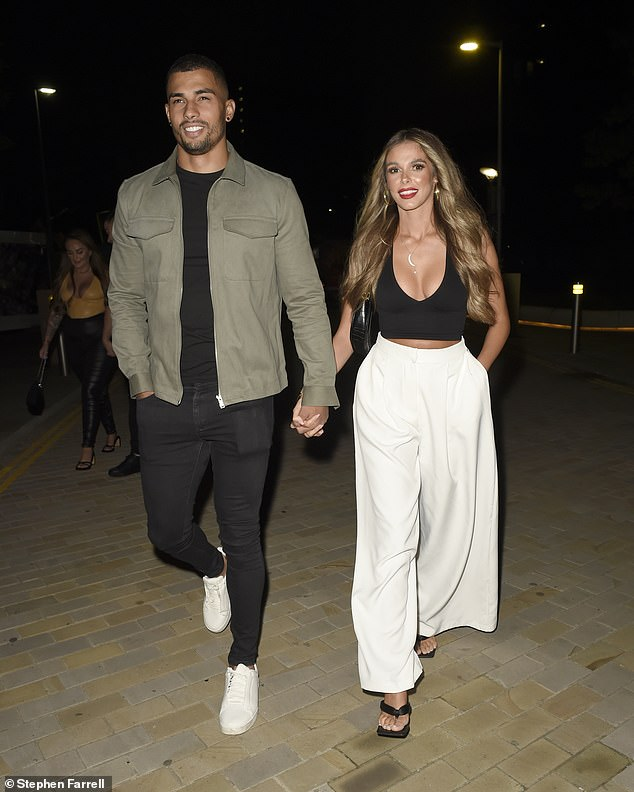 Sweet: Love Island's Conagh Howard, 29, and her The Circle star girlfriend, Beth Dunaway, 30, appeared to be making love while enjoying a date night at the menagerie in Manchester on Friday.