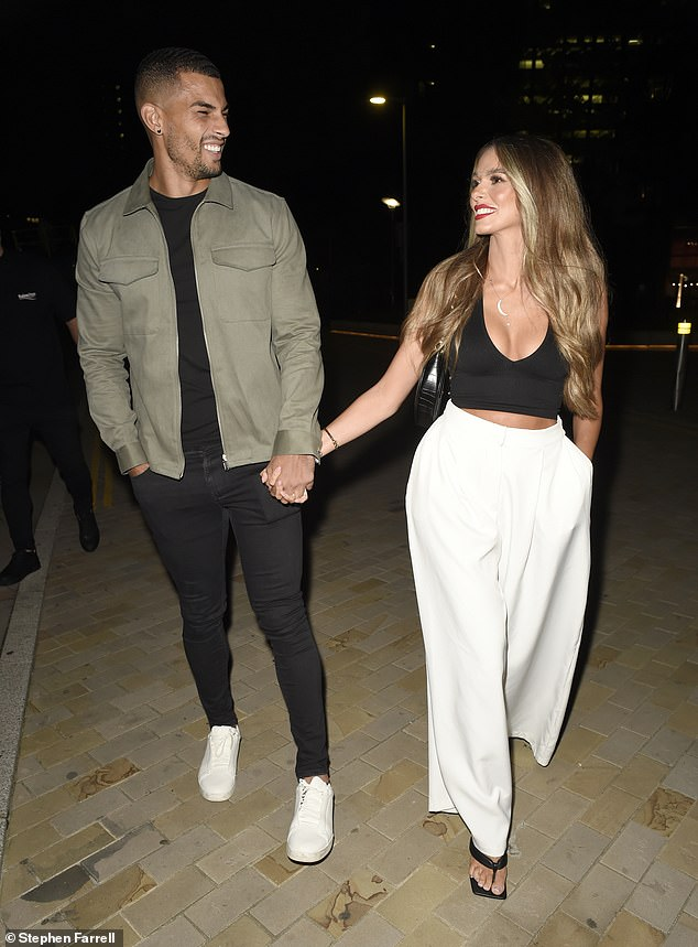 Style: Holding hands with her boyfriend, Beth made a stunning appearance in a black crop top, which she paired with wide-legged white trousers