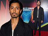 Riz Ahmed looks suave in a black collared zip-up jacket at the premiere of his movie Encounter