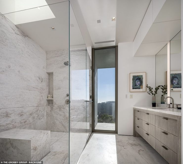 Stunning bathrooms: Living amenities include: a cabana, exterior bar/kitchen, sun deck, gym, spa, a steam room and office