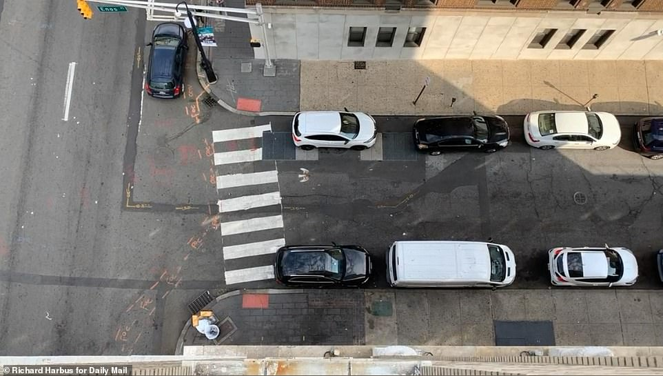 A suicidal man who survived a leap from a high-rise building in New Jersey and landed on a BMW was caught on video crawling to the ninth floor, which was under construction