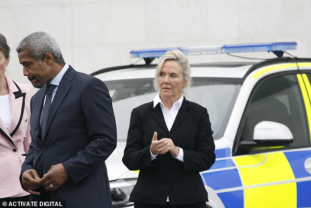 Back in role: In one shot, Amanda - also renowned for her appearance in soap Brookside - appeared deep in thought as she stood beside a police car