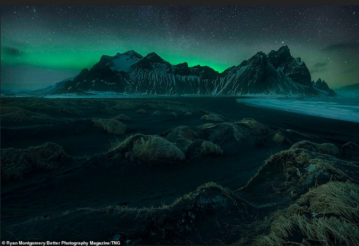 One mystical landscape picture from Ryan Montgomery captures the sub-zero frozen terrains of Iceland. The aurora borealis is seen above deserted mountains of Vestrahorn in the snap