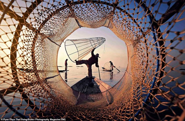 Pyae Phyo Thet Paing, from Myanmar, caught the judges' eyes with his nature shot of fishermen using traditional nets in Inle Lake