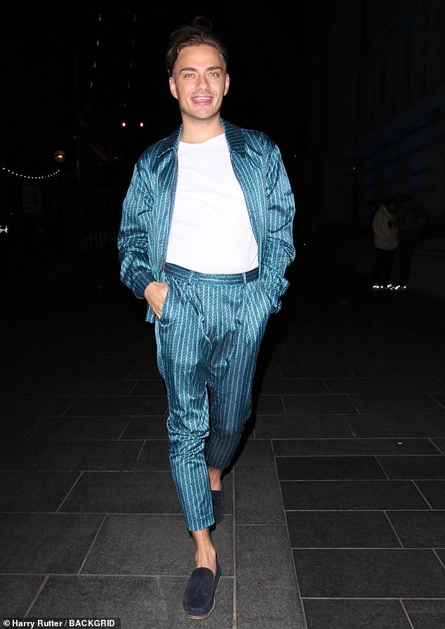 Dapper: Freddie looked drab in a white T-shirt, blue patterned silk jacket and matching pants.  She completed the look with dark blue suede loafers