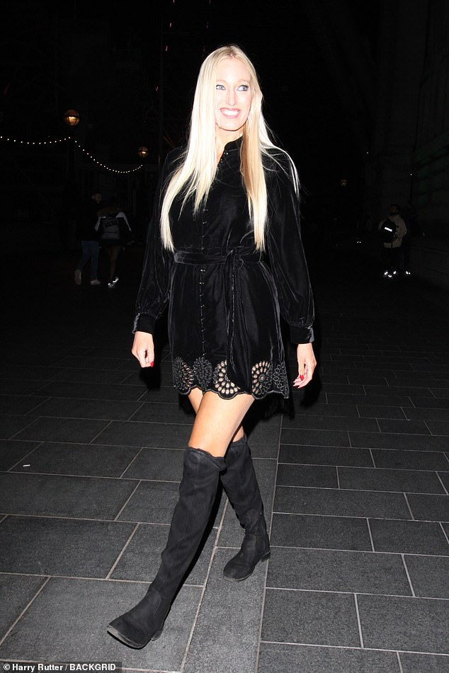 Leggy lady: Hayley shows off her leggy figure in a black suede thigh-skimming dress with knee-high black suede boots