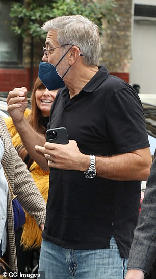Safety first: George also donned a blue face mask as he made his way to the venue