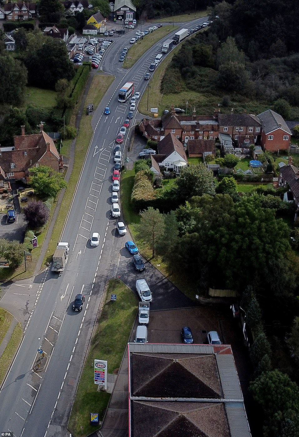 The South East is still in the grip of a fuel crisis despite Transport Secretary Grant Shapps today claiming supply levels are 'close to normal range'. Pictured: Queues for Esso in Ashford
