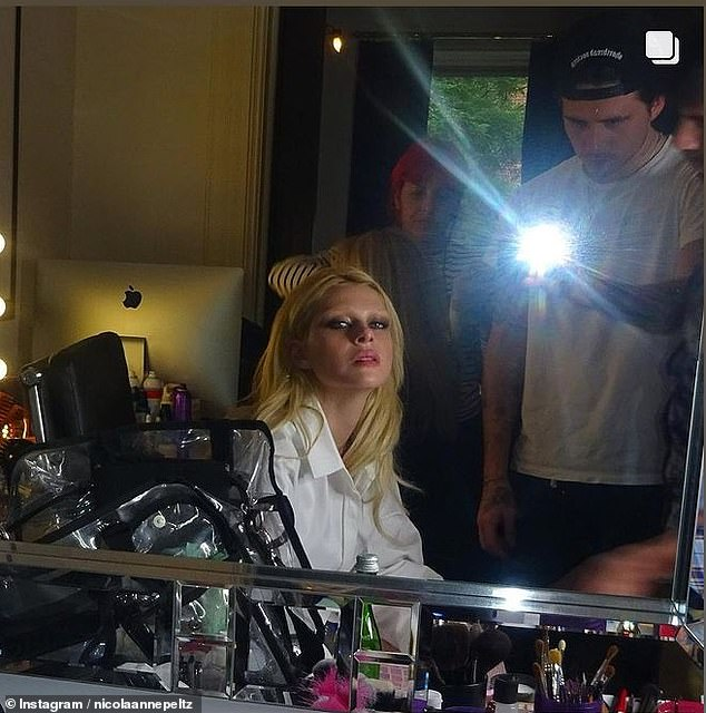 If the look could kill: Nicola also shared a photo of herself patting in the mirror after having her makeup professionally applied, with her doting partner taking a mirror selfie