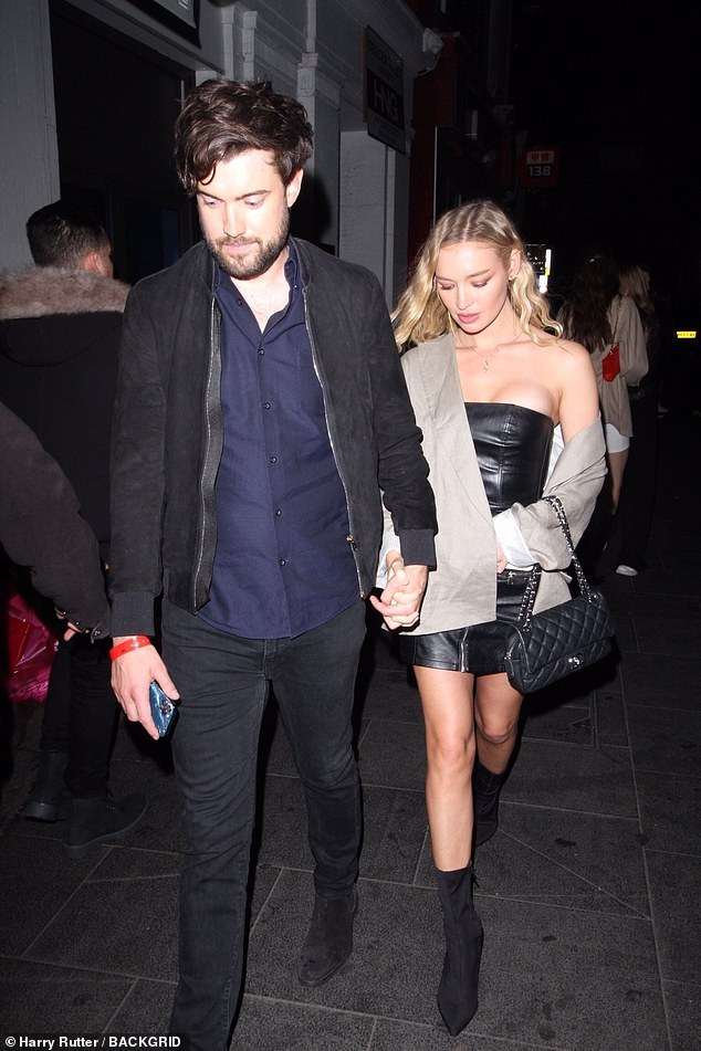Love-up: Jack Whitehall, 33, and his stunning girlfriend Roxy Horner, 30, walk hand-in-hand (both images)