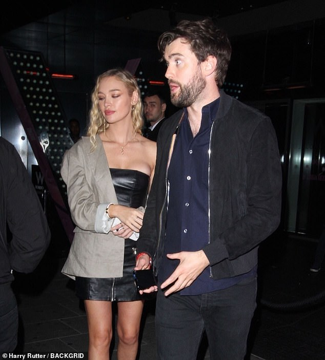 Attire: Jack cut a polished figure in a navy dress shirt, black jeans, a coordinating jacket and black suede boots