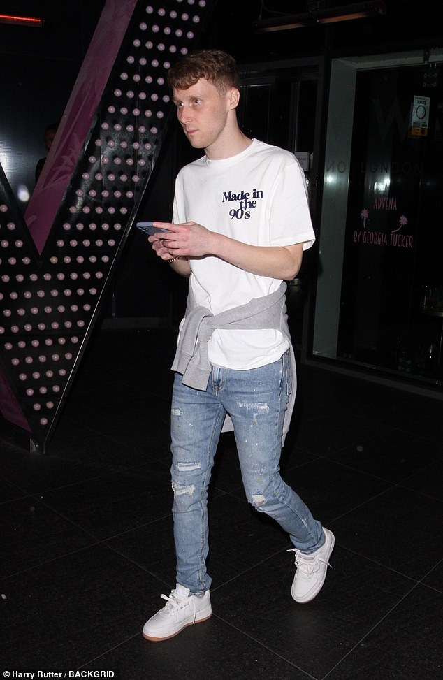 Cool and casual: The soap star kept things cool and casual in a white slogan T-shirt, distressed blue jeans and vintage white sneakers.