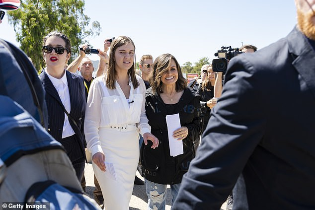 Talking: Lisa has been outspoken on the case and in March, she appeared at the Australian March4Justic protest, where she read a speech written by Higgins. Pictured together