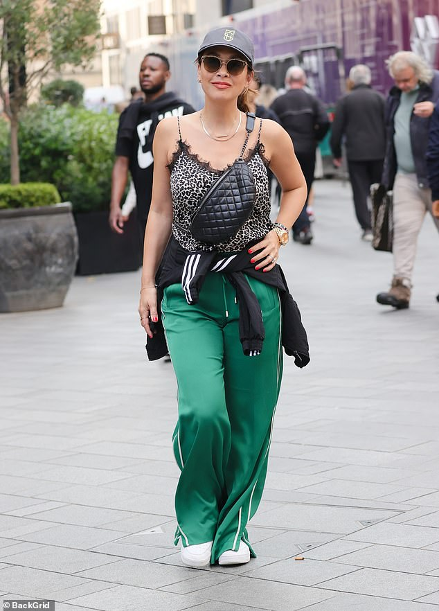 , Myleene Klass cuts a chic figure in a silky leopard print top as she heads to work at Smooth Radio, The Today News USA