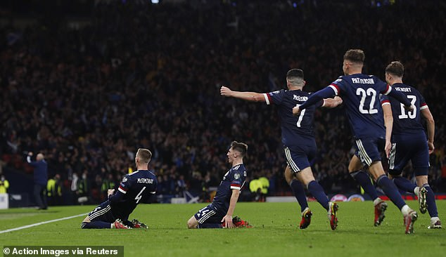 The Manchester United star is flocked by his team-mates after scoring the late winner