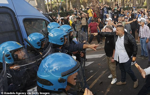 Dramatic photographs showed police in helmets and carrying shields and batons, blocking the groups from marching down a street that runs past Premier Mario Draghi's office