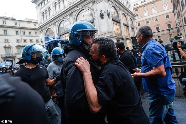 Policemen clash with the 'No Green Pass' protesters in the centre of Rome after they went on an unauthorised protest