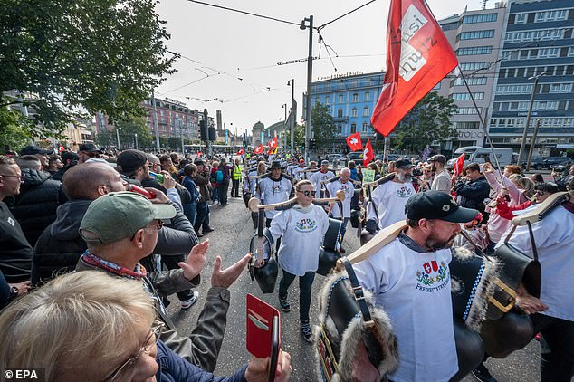 Demonstrators gathered in Basel, Switzerland, to protest after the Government made it mandatory to have a Covid certificate for vaccination or negative test to enter public places