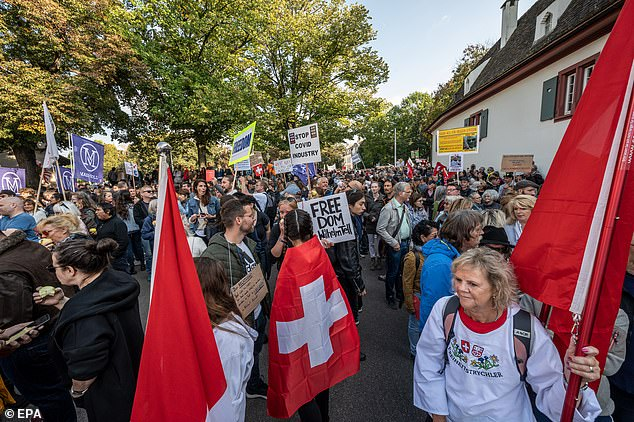 Protesters and members of the 'Freiheitstrychler' group during a demonstration against civil restrictions and the coronavirus vaccine, in Basel, Switzerland