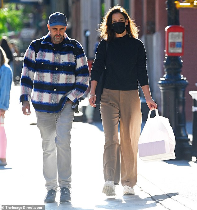Out and about:Katie Holmes was spotted strolling the streets of Manhattan with a male friend on Saturday