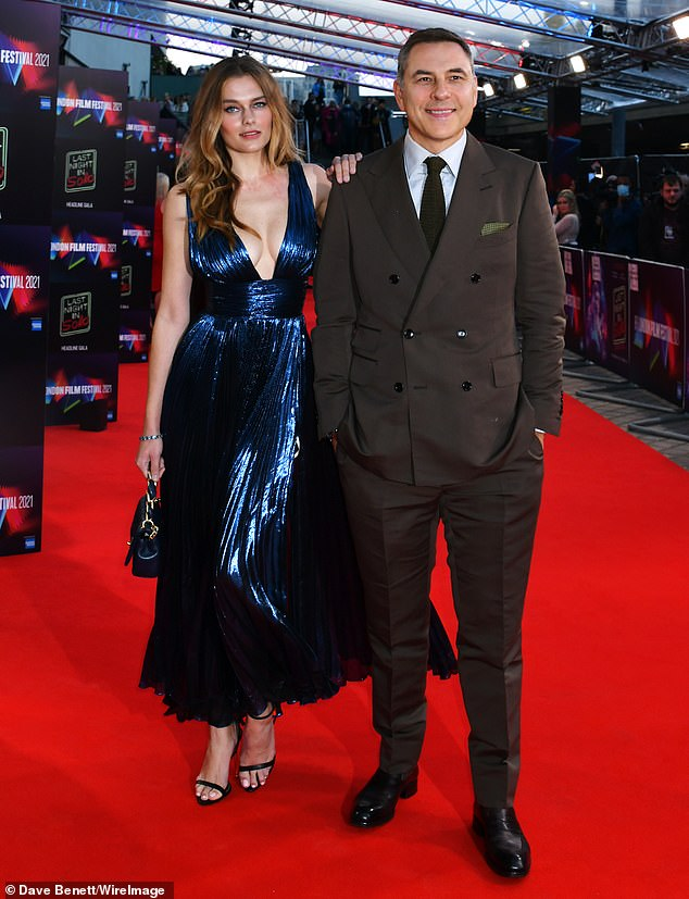 David Williams was joined by his 'friend' Keeley Hazell at the London premiere of the Last Night In Soho during the 65th BFI London Film Festival on Friday