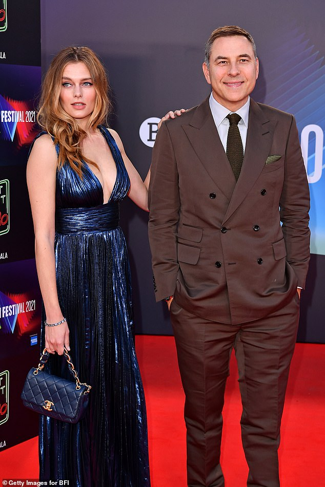 The comedian, 50, and his close model 'friend', 34, put on a tactile display, with the model lovingly placing a hand on his shoulder amid romance rumours
