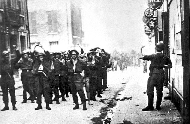 The Admiralty, he explained, was preparing a report on the disastrous Dieppe Raid of 1942, which had seen more than 3,300 Canadian, British and American troops killed or captured within ten hours. Pictured:Canadian troops are ordered to raise their hands by a German soldier after being captured