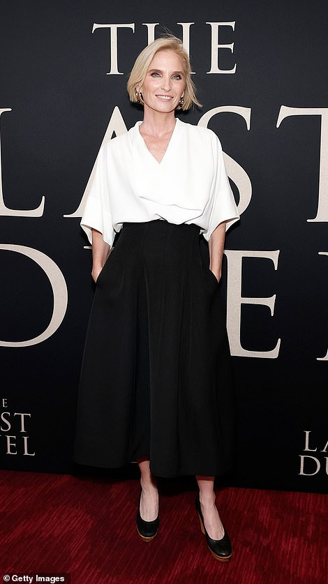 Black and white:Jennifer Fox, who produced The Last Duel, contrasted her with a more reserved white blouse and a black skirt