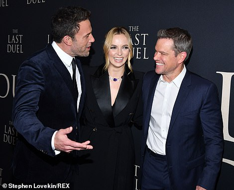 Taking it easy:Comer was seen chatting and grinning with Affleck and Damon on the red carpet