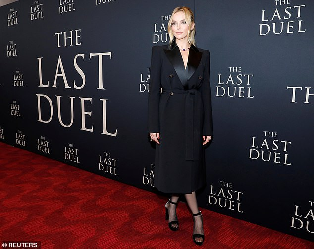 Finishing touches: Black stockings and open-toe black platform heels rounded out the Killing Eve star's look