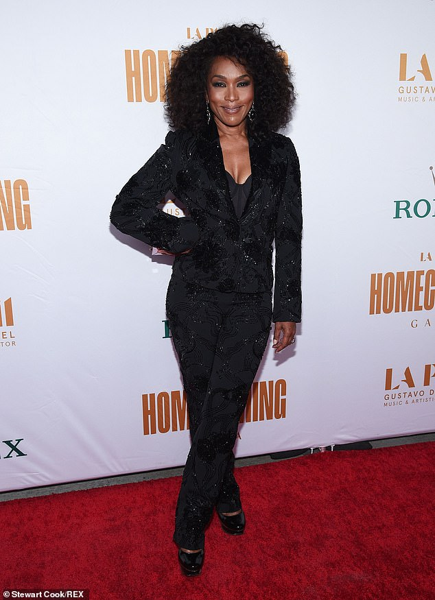 Stunning: Her ageless visage was impeccably made up and her curly tresses voluminous